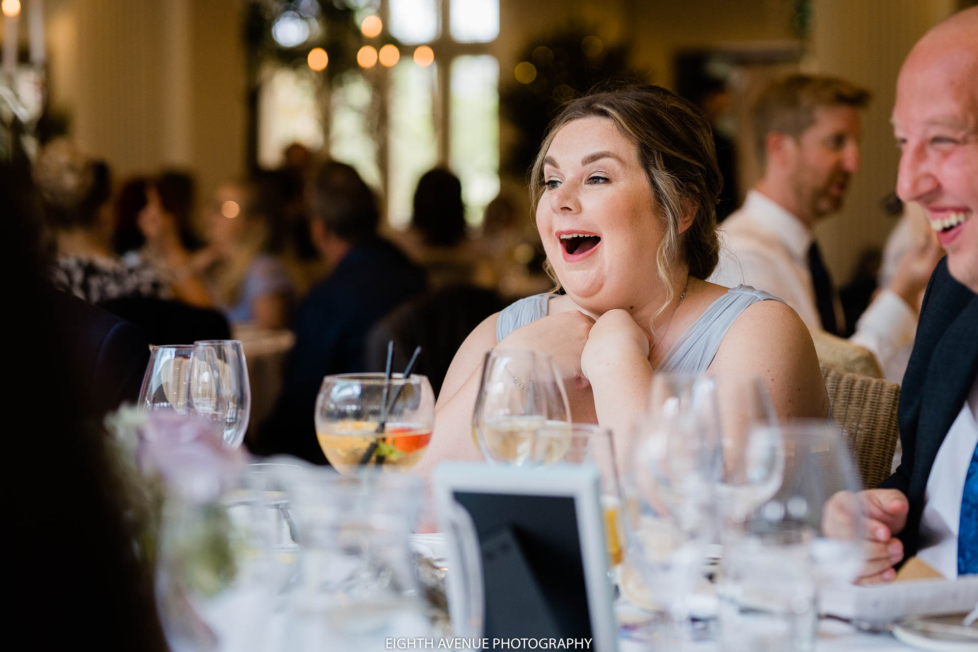 wedding guest laughin