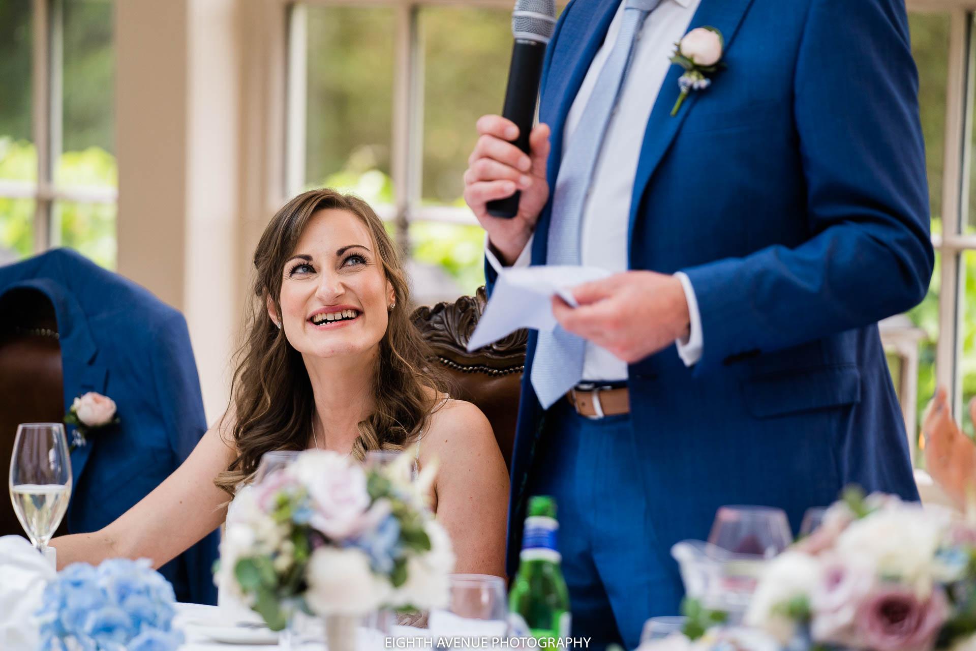 bride smiling during speeches