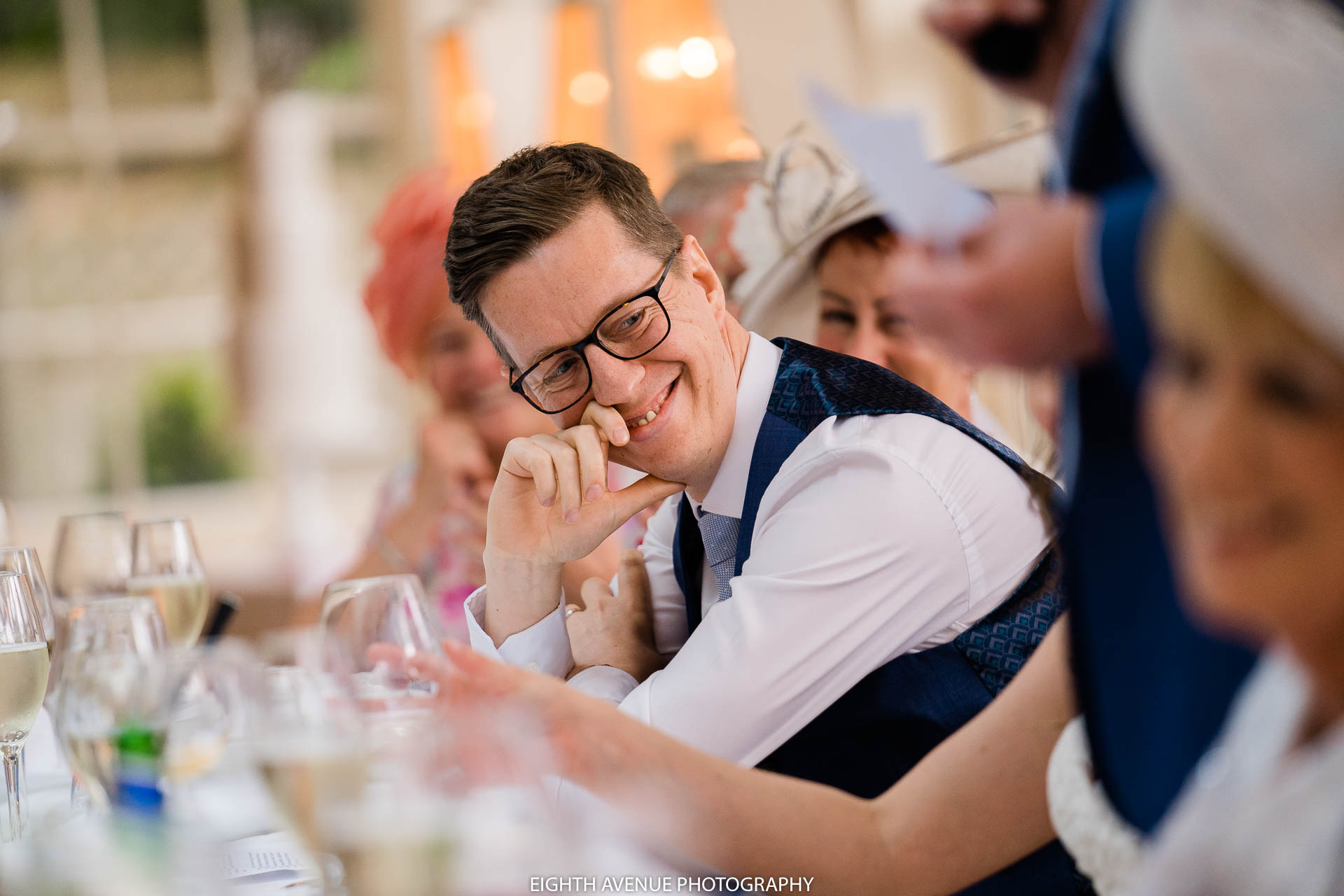 groom laughing in speeches